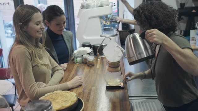 Barista in a small coffee shop. Lifestyle in Barcelona. Small coffee shop. wait staff stock videos & royalty-free footage