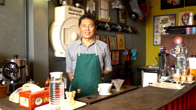 Barista in vintage style coffee shop video