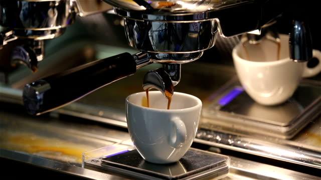 Barista makes coffee in the coffee machine. White coffee mug. video