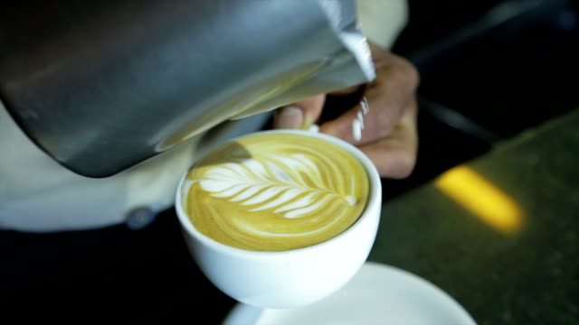 Barista making art latte video