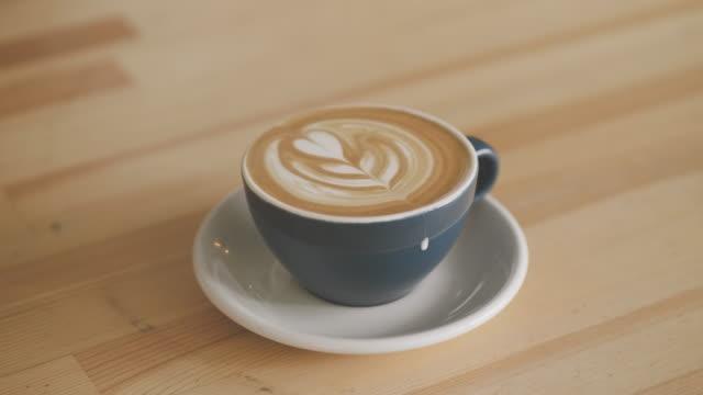 Barista making latte art at a cafe