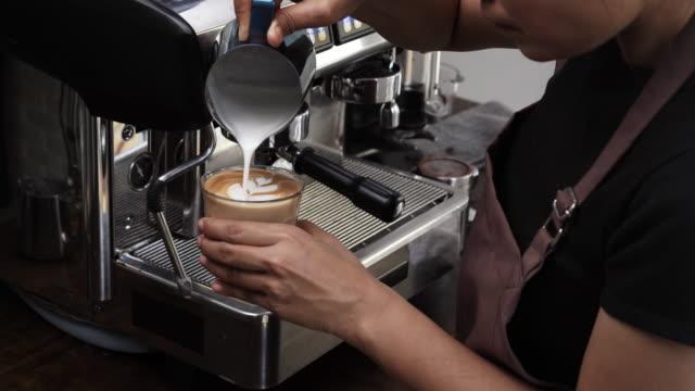 Barista making Latte art with milk foam