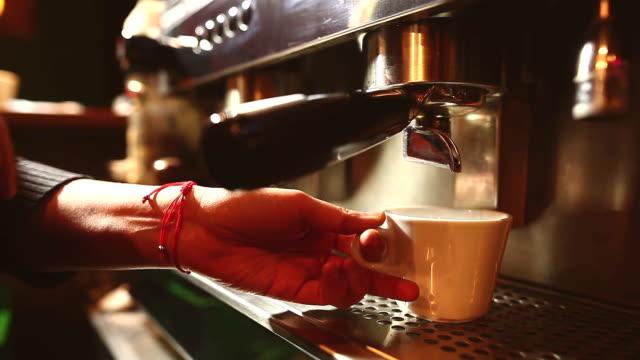 Barista preparing an espresso coffee in a bar. - video