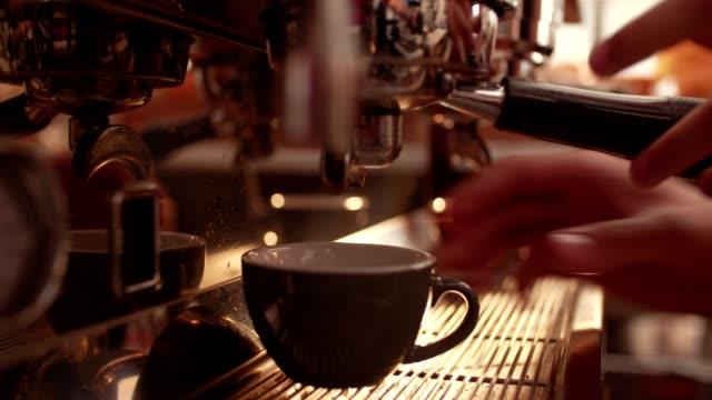 Barista preparing coffee machine and brewing espresso coffee at cafe