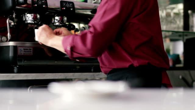 barista serving a cup of fresh brewed espresso coffee - espresso filmów i materiałów b-roll