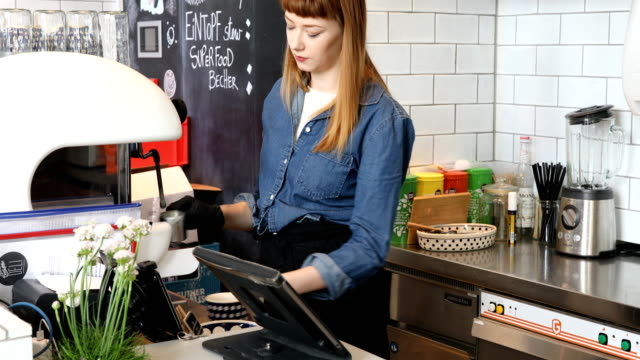 Barista Serving Burger And Coffee To Customer video