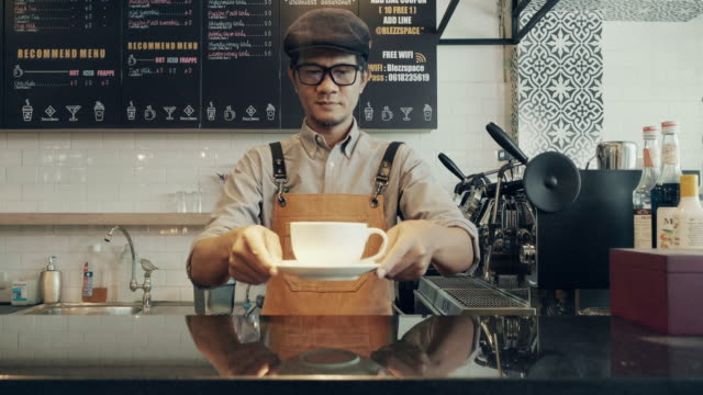 Barista serving cup of coffee