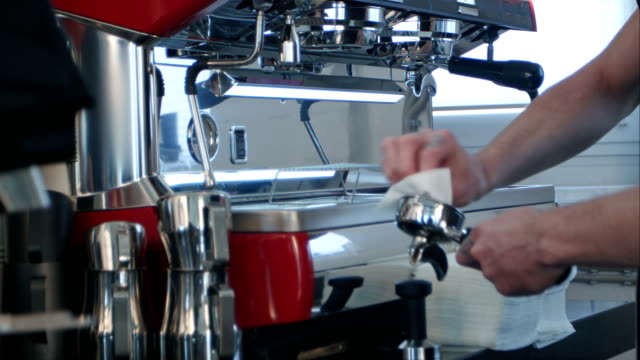Barista take coffee grind in group, prepare to brewing espresso shot video