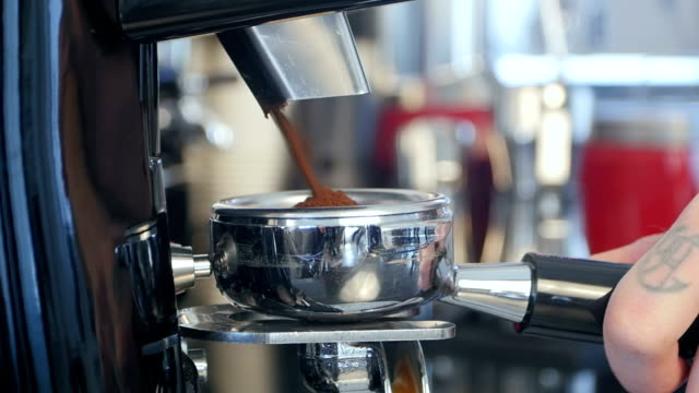barista take coffee grind in group - barista stock videos and b-roll footage