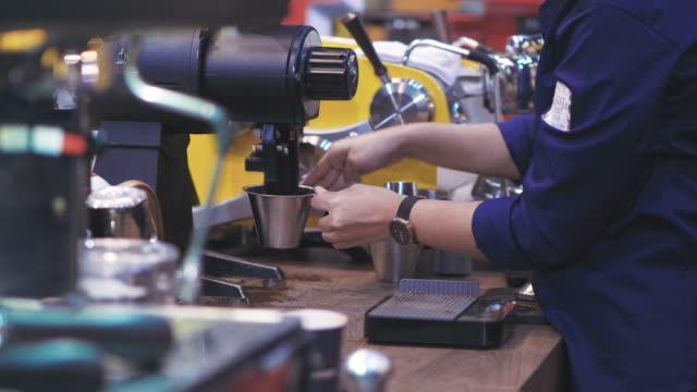 Barista take coffee grind video