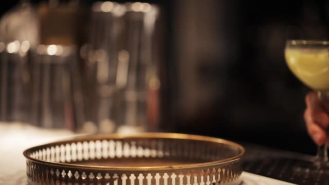 barmaid with glasses of cocktails at bar alcohol drinks, people and luxury concept - barmaid putting glasses of cocktails to tray at bar tray stock videos & royalty-free footage