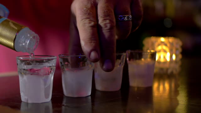 Barman pouring alcohol video