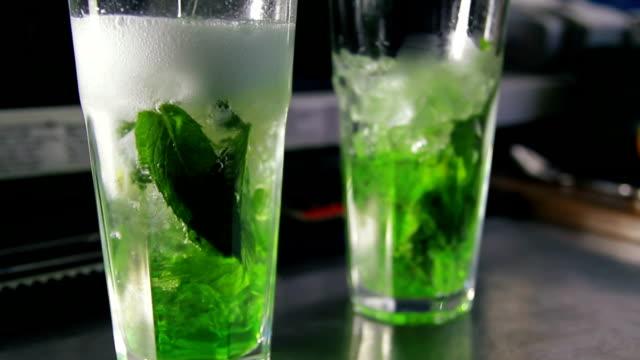 Barman pouring lemonade into glass video