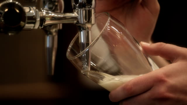 Barman pours pint Bar tender pulling a pint of beer faucet stock videos & royalty-free footage