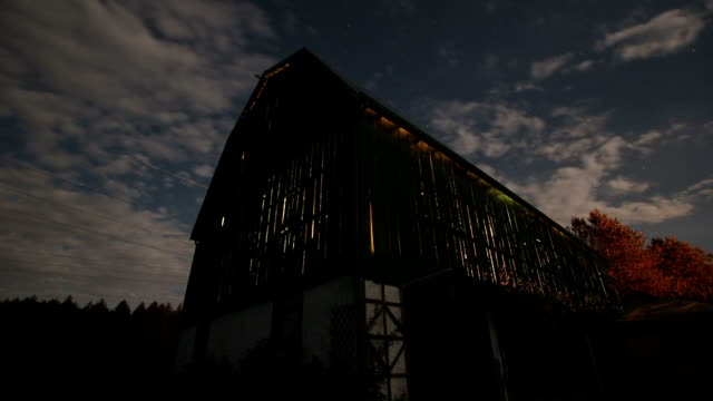 Barn night time lapse A tracking night time lapse shot of a barn with the farm country of Ontario barns stock videos & royalty-free footage