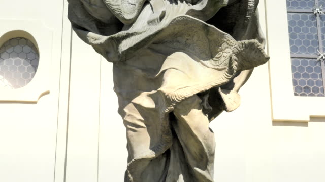 Baroque sandstone statue, Christian holy saint, stone sculpture video