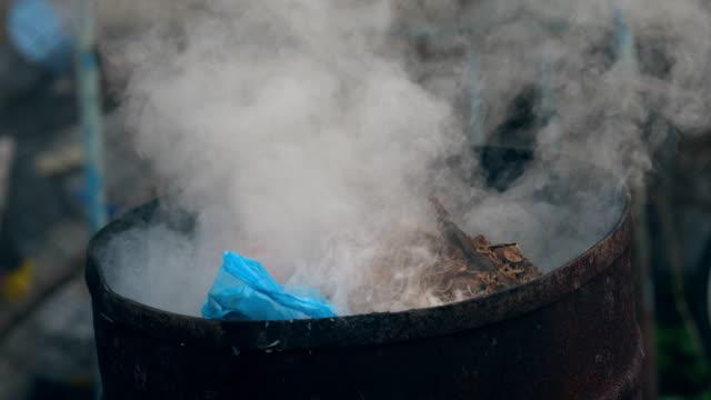 Barrel of burning rubbish video