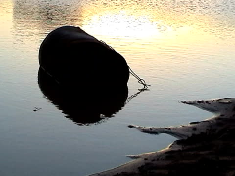 barrel on a dirty lake at sunset - imperfection stock videos & royalty-free footage