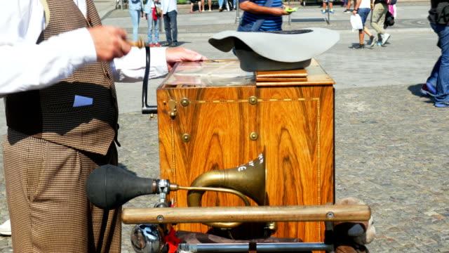 Barrel Organ Player Performing (4K/UHD to HD) video