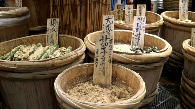 barrels of pickled cucumber in miso for sale at nishiki market video