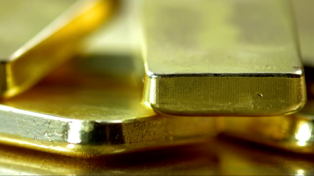 Bars Of Gold HD1080p: Close-up panning shot of bars of pure gold. ingot stock videos & royalty-free footage