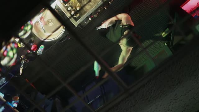Bartender juggling bottles and shaking cocktail at a bar. video