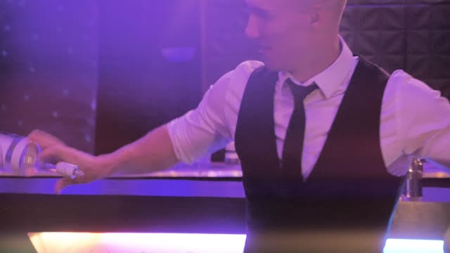 Bartender juggling the bottle on bar in slow motion, bartender show video