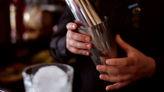Bartender make cocktail in a bar video