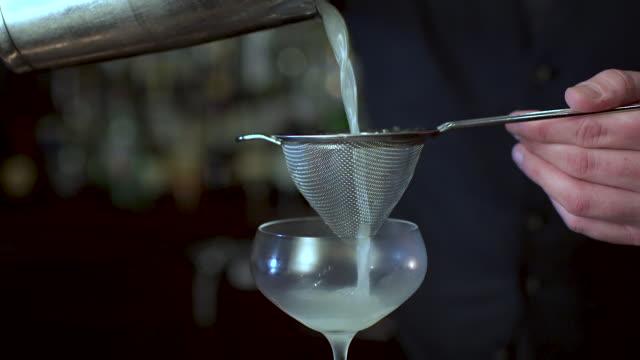 Bartender Making a fancy Margarita Bartender Making a fancy Margarita margarita stock videos & royalty-free footage