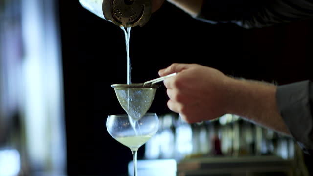 bartender making a fancy margarita - bancone bar video stock e b–roll