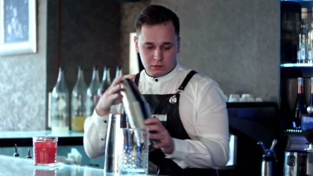 Bartender making alcohol coctail in restaurant video