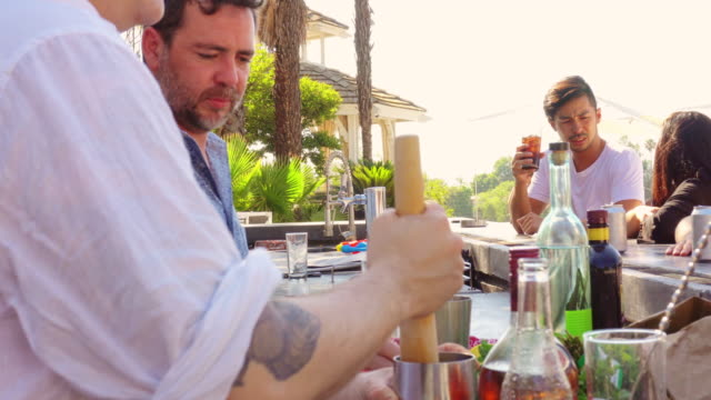 Bartender Making Drinks at Pool Party video