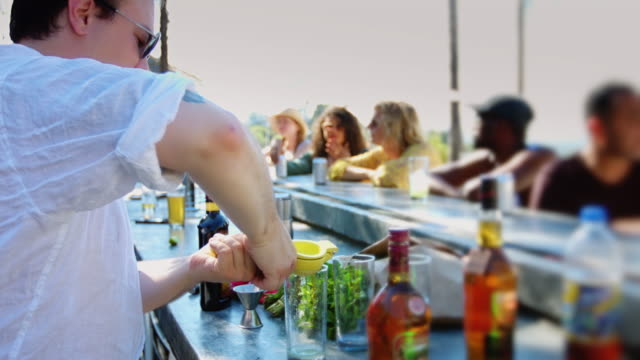 Bartender Mixing Drinks at Summer Pool Party video