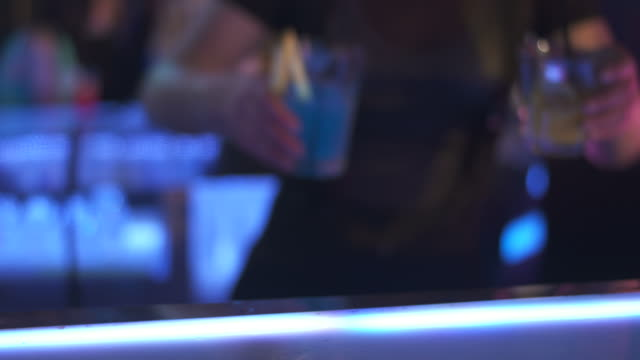 HD: Bartender Passing Glasses Of Drinks video
