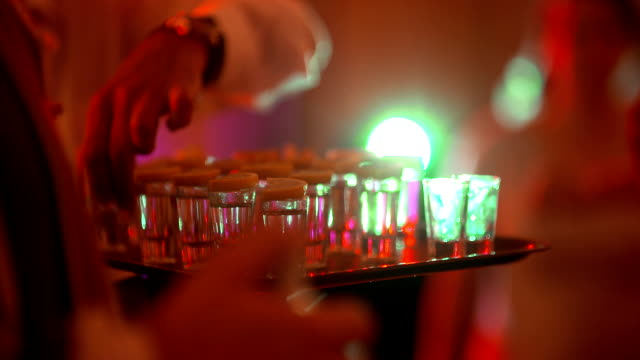 bartender pouring drink (party background) - vodka video stock e b–roll