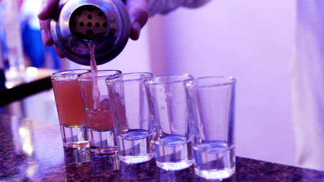 bartender pouring drink (party background) - bartender stock videos and b-roll footage