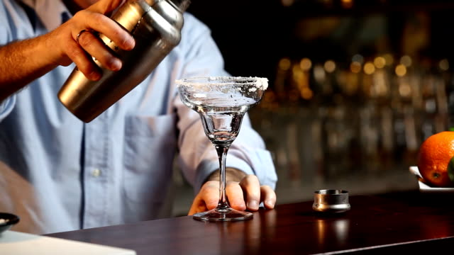 Bartender Serving A Margarita Cocktail Close up of a bartender serving a Margarita cocktail margarita stock videos & royalty-free footage