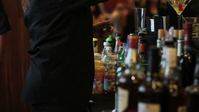 Bartender serving drinks at open bar video