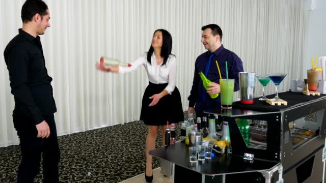 Bartender teaching girl flair bartending techniques video