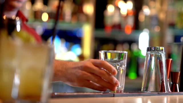 bartender working in bar counter - bicchiere vuoto video stock e b–roll