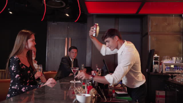 Bartenders are brewing for tourists. Who came to socialize after work time