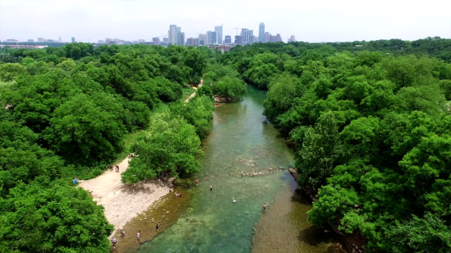 Barton Springs with Austin Cityscape Skyline Aerial Shot of Texas Hill Country Paradise 4K video