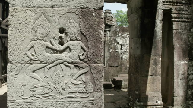 bas relief of female apsaras dancers and lotus flowers at banteay kdei temple