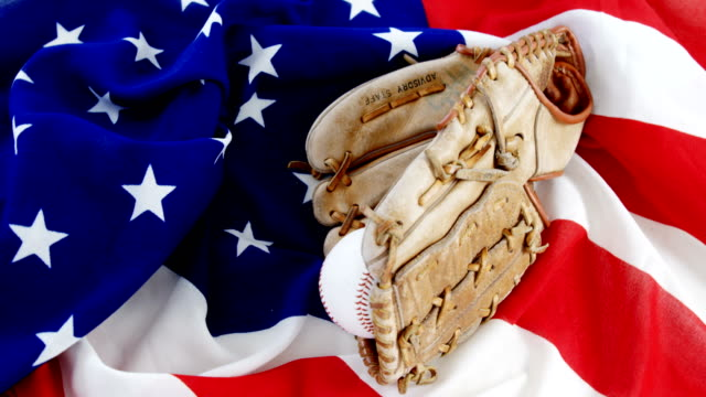 Baseball and gloves on an American flag video