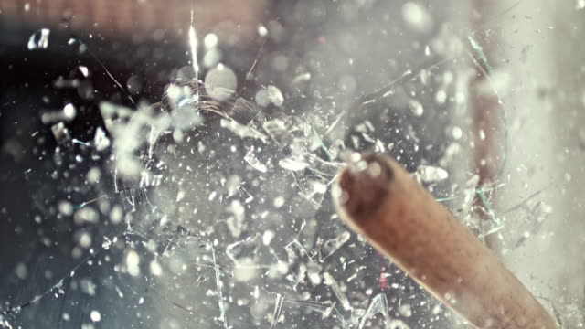 SLO MO LD Baseball bat smashing a glass window Slow motion close up locked down shot of a baseball bat being used to smash a glass window. Shot in Slovenia. breaking stock videos & royalty-free footage
