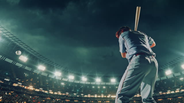 Baseball batter hitting a ball during game video