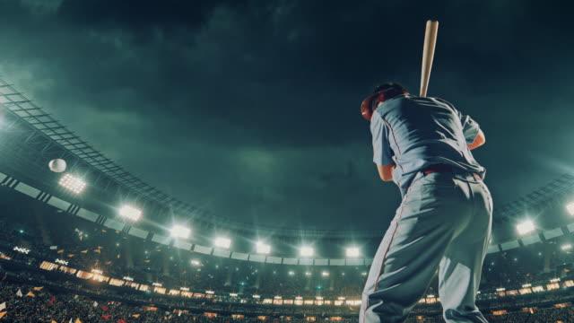 baseball batter hitting a ball during game - oscillare video stock e b–roll