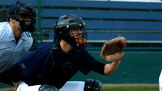 Baseball catcher catches ball, slow motion video