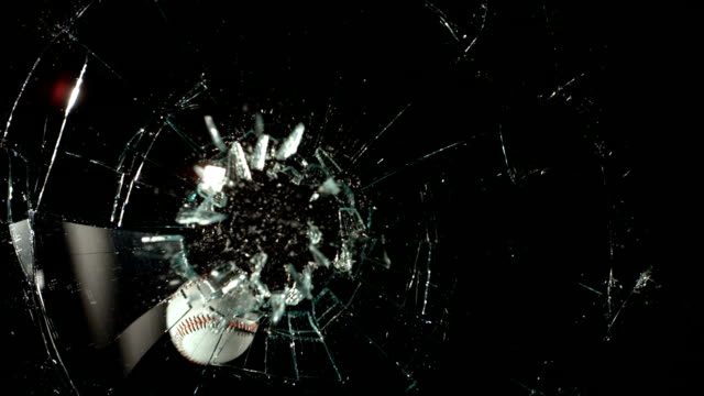 Baseball hitting glass window, slow motion video