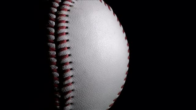 Baseball on black with copy space - HD video
